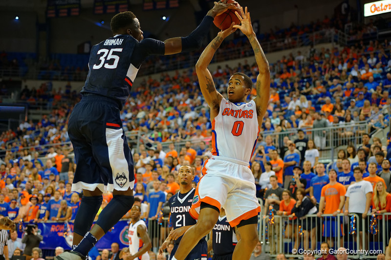 Florida Gators guard Kasey Hill has a shot blocked by UCONN Huskies center Amida Brimah during the second half.  Florida Gators vs UCONN Huskies.  January 3rd, 2015. Gator Country photo by David Bowie.