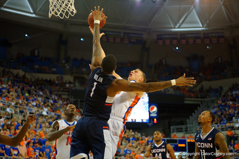 Florida Gators forward Alex Murphy drives to the basket over UCONN Huskies forward Phillip Nolan during the first half.  Florida Gators vs UCONN Huskies.  January 3rd, 2015. Gator Country photo by David Bowie.