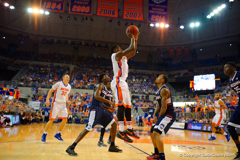 Florida Gators guard Eli Carter with a jump shot during the second half.  Florida Gators vs UCONN Huskies.  January 3rd, 2015. Gator Country photo by David Bowie.