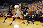 Florida Gators guard Chris Chiozza defends UCONN Huskies guard Omar Calhoun during the second half.  Florida Gators vs UCONN Huskies.  January 3rd, 2015. Gator Country photo by David Bowie.
