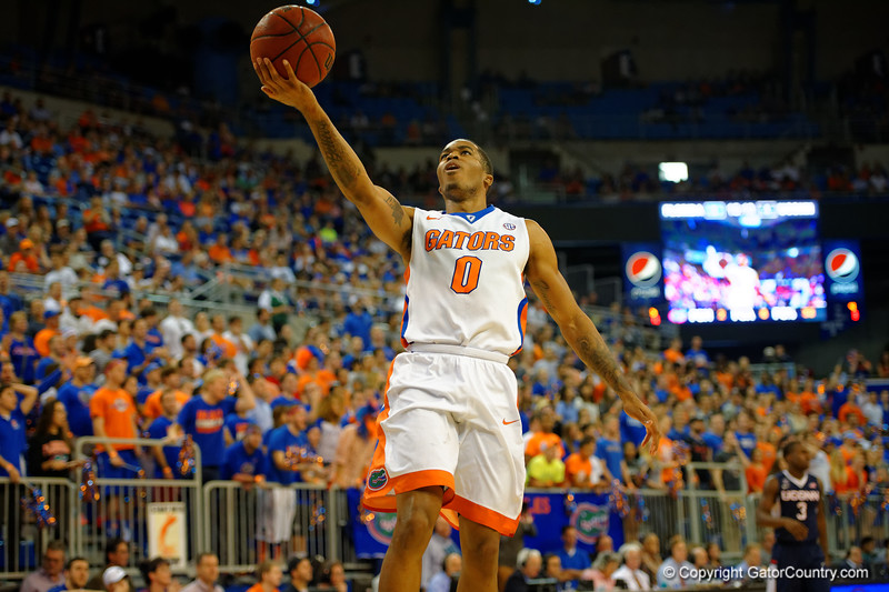 Florida Gators guard Kasey Hill lays in a basket during the first half.  Florida Gators vs UCONN Huskies.  January 3rd, 2015. Gator Country photo by David Bowie.
