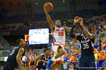 Florida Gators guard Michael Frazier II flies toward the basket during the second half.  Florida Gators vs UCONN Huskies.  January 3rd, 2015. Gator Country photo by David Bowie.
