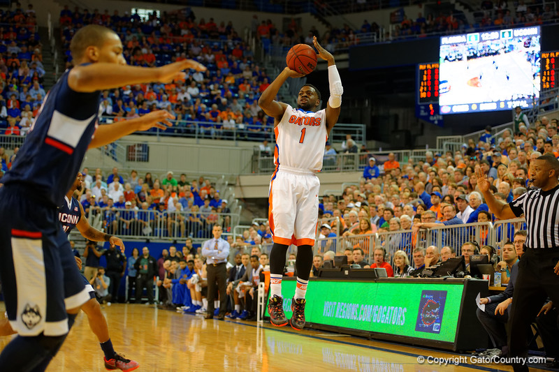 Florida Gators guard Eli Carter hits a three pointer in the first half.  Florida Gators vs UCONN Huskies.  January 3rd, 2015. Gator Country photo by David Bowie.