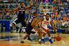 Florida Gators guard Michael Frazier II dribbles up court past UCONN Huskies forward Phillip Nolan and UCONN Huskies guard Rodney Purvis during the first half.  Florida Gators vs UCONN Huskies.  January 3rd, 2015. Gator Country photo by David Bowie.