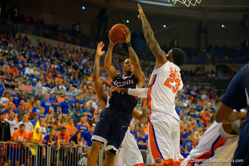 UCONN Huskies guard Ryan Boatright drives to the basket while Florida Gators forward Chris Walker defends.  Florida Gators vs UCONN Huskies.  January 3rd, 2015. Gator Country photo by David Bowie.