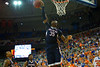 UCONN Huskies center Amida Brimah blocks the shot attempt by Florida Gators guard Michael Frazier II.  Florida Gators vs UCONN Huskies.  January 3rd, 2015. Gator Country photo by David Bowie.
