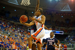 Florida Gators guard Kasey Hill leaps into the air and scores on the reverse layup in the first quarter.  Florida Gators vs UCONN Huskies.  January 3rd, 2015. Gator Country photo by David Bowie.