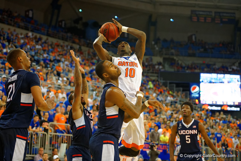 Florida Gators forward Dorian Finney-Smith puts up a shot attempt during the first half.  Florida Gators vs UCONN Huskies.  January 3rd, 2015. Gator Country photo by David Bowie.