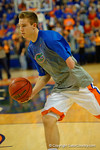 Florida Gators guard Zach Hodskins dribbles to toward the net during pre-game drills.  Florida Gators vs UCONN Huskies.  January 3rd, 2015. Gator Country photo by David Bowie.