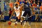Florida Gators guard Eli Carter dribbles up court during the second half.  Florida Gators vs UCONN Huskies.  January 3rd, 2015. Gator Country photo by David Bowie.