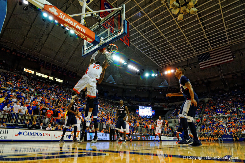 Florida Gators forward Chris Walker lays in a bucket during the first half.  Florida Gators vs UCONN Huskies.  January 3rd, 2015. Gator Country photo by David Bowie.