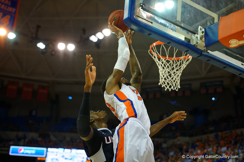 Florida Gators forward Chris Walker with a late shot attempt in the second half.  Florida Gators vs UCONN Huskies.  January 3rd, 2015. Gator Country photo by David Bowie.
