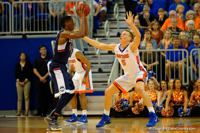Florida Gators forward Alex Murphy on defense in the first half.  Florida Gators vs UCONN Huskies.  January 3rd, 2015. Gator Country photo by David Bowie.