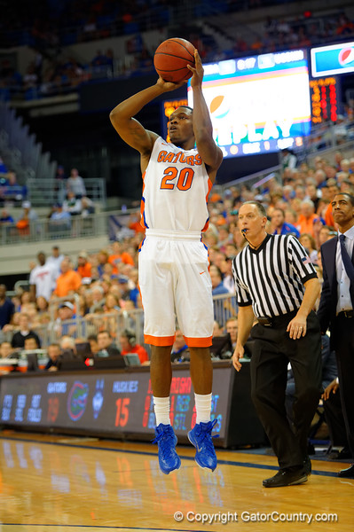 Florida Gators guard Michael Frazier II makes a three point basket in the first half.  Florida Gators vs UCONN Huskies.  January 3rd, 2015. Gator Country photo by David Bowie.
