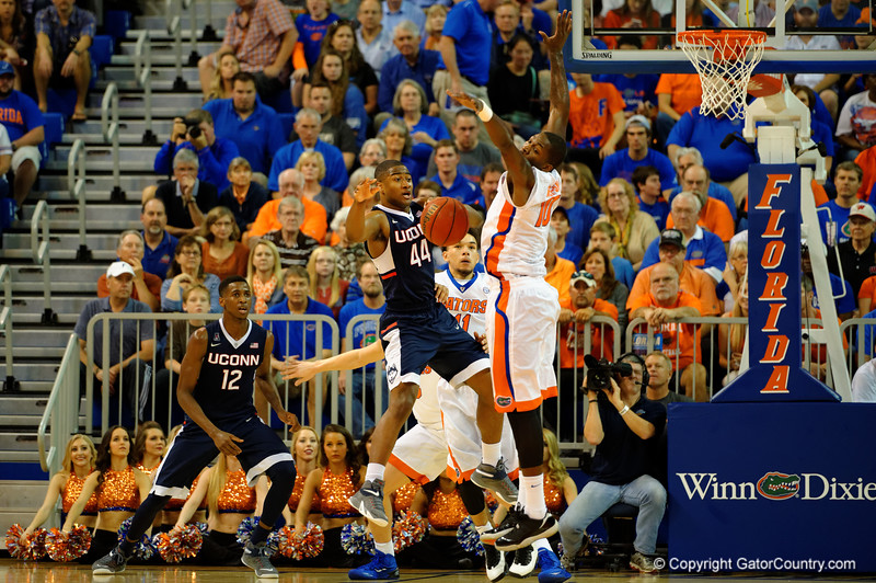 Florida Gators forward Dorian Finney-Smith blocks the shot attempt by UCONN Huskies guard Rodney Purvis in the first half.  Florida Gators vs UCONN Huskies.  January 3rd, 2015. Gator Country photo by David Bowie.