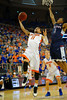 Florida Gators guard Chris Chiozza drives to the basket past UCONN Huskies guard Ryan Boatright in the first half.  Florida Gators vs UCONN Huskies.  January 3rd, 2015. Gator Country photo by David Bowie.