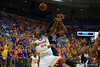 Florida Gators forward Chris Walker fights for a rebound against UCONN center Amida Brimah during the first half.  Florida Gators vs UCONN Huskies.  January 3rd, 2015. Gator Country photo by David Bowie.