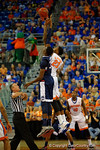 Florida Gators forward Chris Walker leaps during the tip-off.  Florida Gators vs UCONN Huskies.  January 3rd, 2015. Gator Country photo by David Bowie.