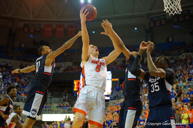 Florida Gators forward Alex Murphy lays up a shot attempt during the second half.  Florida Gators vs UCONN Huskies.  January 3rd, 2015. Gator Country photo by David Bowie.