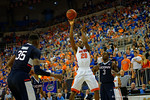Florida Gators guard Michael Frazier II with a shot attempt during the second half.  Florida Gators vs UCONN Huskies.  January 3rd, 2015. Gator Country photo by David Bowie.
