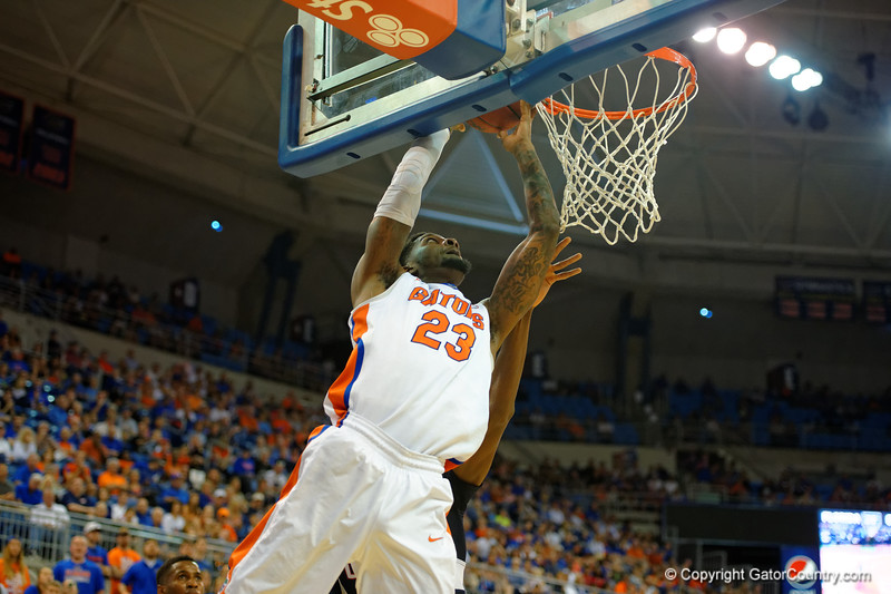 Florida Gators forward Chris Walker scores on a lay in during the first half.  Florida Gators vs UCONN Huskies.  January 3rd, 2015. Gator Country photo by David Bowie.