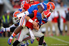 Florida Gators defensive lineman Dante Fowler, Jr. sacks Georgia Bulldogs quarterback Hunter Mason.  Florida Gators vs Georgia Bulldogs.  November 1st, 2014. Gator Country photo by David Bowie.