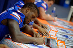 Florida Gators running back Kelvin Taylor signs a poster for a fan during the 2015 Florida Gators Fan Day.  August 15th, 2015.  Gator Country Photo by David Bowie.