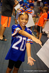 A young Gators fan poses as the Florida Gators sign posters and take photos with the fans during the Florida Gators 2015 Fan Day.  August 15th, 2015.  Gator Country Photo by David Bowie.