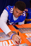 Florida Gators defensive back Jalen Tabor signs a poster during the 2015 Florida Gators Fan Day.  August 15th, 2015.  Gator Country Photo by David Bowie.