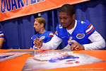 Florida Gators quarterback Treon Harris signs a poster for a fan during the 2015 Florida Gators Fan Day.  August 15th, 2015.  Gator Country Photo by David Bowie.