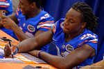 Florida Gators defensive back Marcell Harris signs a poster during the 2015 Florida Gators Fan Day.  August 15th, 2015.  Gator Country Photo by David Bowie.