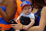 A baby Gators fan shows off his first Gator cap during the 2015 Florida Gators Fan Day.  August 15th, 2015.  Gator Country Photo by David Bowie.