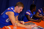 Florida Gators tight end Jake McGee signs a poster for a fan during the 2015 Florida Gators Fan Day.  August 15th, 2015.  Gator Country Photo by David Bowie.