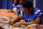 Florida Gators running back Tyriek Hopkins signs a poster during the 2015 Florida Gators Fan Day.  August 15th, 2015.  Gator Country Photo by David Bowie.