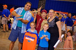 A house divided family poses as Florida Gators sign posters and take photos at the 2015 Florida Gators Fan Day.  August 15th, 2015.  Gator Country Photo by David Bowie.