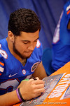 Florida Gators tight end DeAndre Goolsby signs a poster for during the 2015 Florida Gators Fan Day.  August 15th, 2015.  Gator Country Photo by David Bowie.