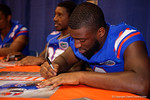 Florida Gators wide receiver Latroy Pittman signs a poster for a fan during the 2015 Florida Gators Fan Day.  August 15th, 2015.  Gator Country Photo by David Bowie.
