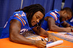 Florida Gators running back Jordan Scarlett signs a poster for a fan during the 2015 Florida Gators Fan Day.  August 15th, 2015.  Gator Country Photo by David Bowie.