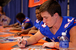 Florida Gators running back Case Harrison signing a poster during the 2015 Florida Gators Fan Day.  August 15th, 2015.  Gator Country Photo by David Bowie.