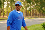 Florida Gators wide receivers coach Kerry Dixon II as the Gators walk off the buses and onto the Dizney Lacrosse Field for practice.  August 8th, 2015.  Gator Country Photo.