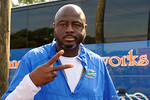 Florida Gators defensive line coach Chris Rumph poses for the camera as the Gators walk off the buses and onto the Dizney Lacrosse Field for practice.  August 8th, 2015.  Gator Country Photo.