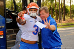 Florida Gators head coach Jim McElwain and Florida Gators linebacker Antonio Morrison pose for the camera as the Gators walk off the buses and onto the Dizney Lacrosse Field for practice.  August 8th, 2015.  Gator Country Photo.