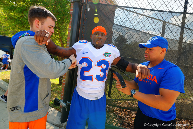 Florida Gators defensive back J.C. Jackson gets helps with his pads.  Florida Gators Third Spring Practice.  March 20th, 2016. Gator Country photo by David Bowie.