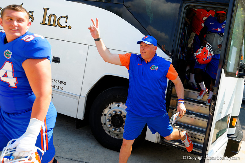 Florida Gators defensive coordinator Geoff Collins runs after Florida Gators defensive lineman Bryan Cox, Jr. trying to put bunny ears on him for the photos.  Florida Gators Third Spring Practice.  March 20th, 2016. Gator Country photo by David Bowie.