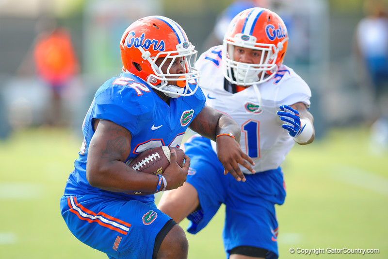 Florida Gators running back Adam Lane Jr. jukes to get by Florida Gators defensive back Jalen Tabor.  Florida Gators Third Spring Practice.  March 20th, 2016. Gator Country photo by David Bowie.