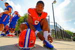 Florida Gators quarterback Treon Harris kneels down to tie his cleats before entering the practice field.  Florida Gators Third Spring Practice.  March 20th, 2016. Gator Country photo by David Bowie.