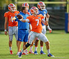 Florida Gators quarterback Will Grier throws downfield as Florida Gators head coach Jim McElwain watches on during the Florida Gators open practice.  August 27th, 2015.  Gator Country Photo by David Bowie.