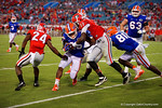 Florida Gators running back Jordan Scarlett is tackled by Bulldogs Deandre Baker in the second half, as the Gators spook the Georgia Bulldogs with a 27-3 win at EverBank Field.  October 31st, 2015. Gator Country photo by David Bowie.