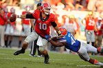 Georgia Bulldogs quarterback Faton Bauta scrambles to get away from a diving Florida Gators defensive back Keanu Neal during the second half, as the Gators spook the Georgia Bulldogs with a 27-3 win at EverBank Field.  October 31st, 2015. Gator Country photo by David Bowie.