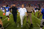 Florida Gators head coach Jim McElwain walks out to greet Georgia head coach Mark Richt as the Gators spook the Georgia Bulldogs with a 27-3 win at EverBank Field.  October 31st, 2015. Gator Country photo by David Bowie.